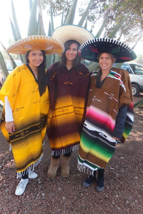 Mexican costume wearing a poncho and sombrero