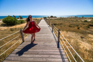happy-girl-dancing-at-the-beach