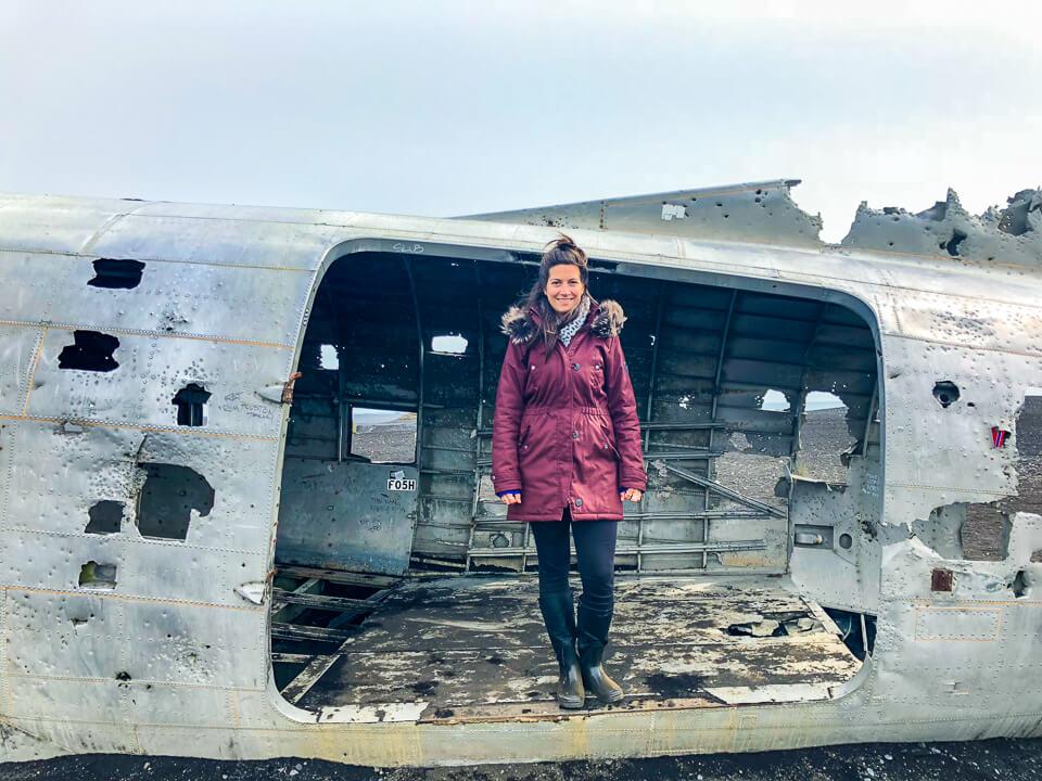 Standing in the crashed US navy plane in Sólheimasandur's in Iceland