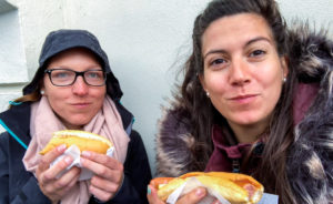 Eating hot dog at Bæjarins Beztu Pylsur in Reykjavik