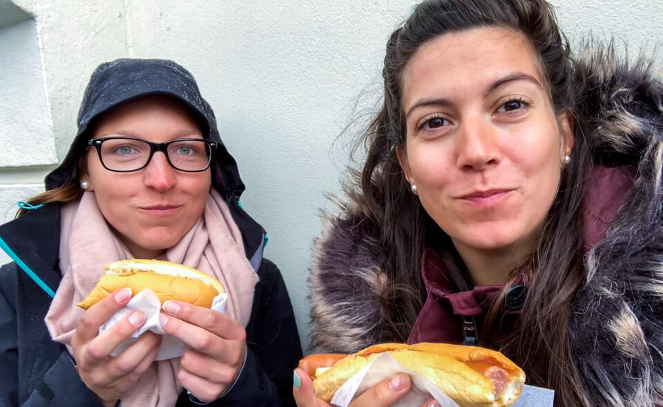 Eating hot dog at Bæjarins Beztu Pylsur in Reykjavik