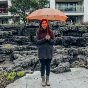 Under-an-orange-Umbrella
